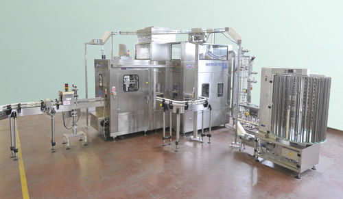 industrial filling machine / for carbonated drinks / can / automatic