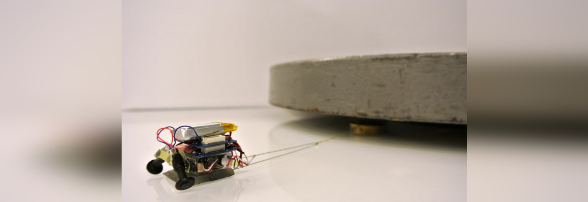 """MICROTUG"" ROBOTS PULL NEARLY 2,000 TIMES THEIR OWN WEIGHT"