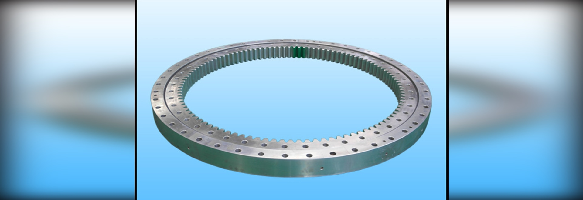 Single row four point contact ball slewing bearing with internal gear