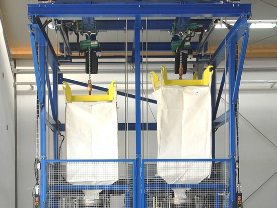 Twin JDN Profi 2 TI hoists, fitted with motorised trolley mountings for big bag handling in chemical, pharmaceutical and food processing environments