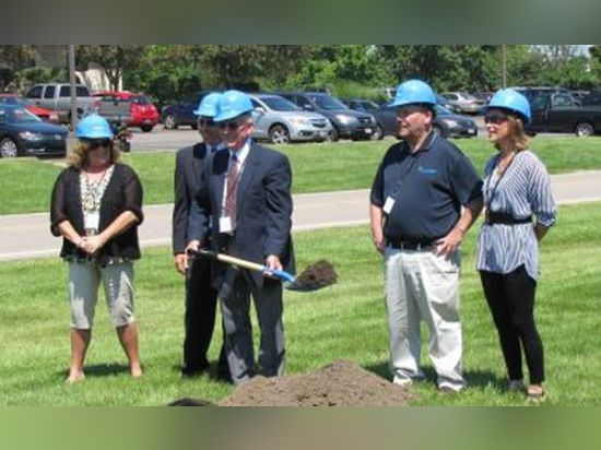 The honor of moving the first shovelful of earth at Hydrotech's groundbreaking belonged to CEO/Owner Pete Jones as other Hydrotech executives stand beside him.