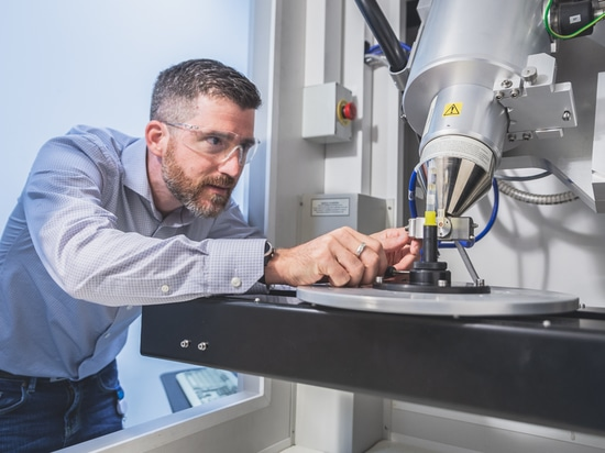 Dr. Fabrice Bernier, researcher at the National Research Council, using an X-ray micro-tomography machine to analyze powders. Photot credit: NRC