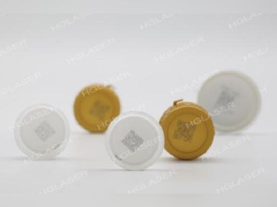 Auto laser marking system on marking bottle caps