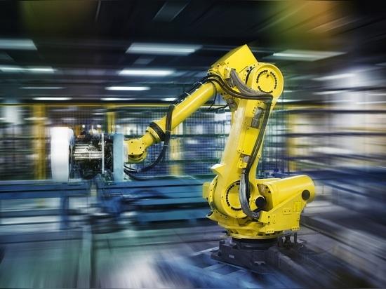 Industrial robots work in a workshop.