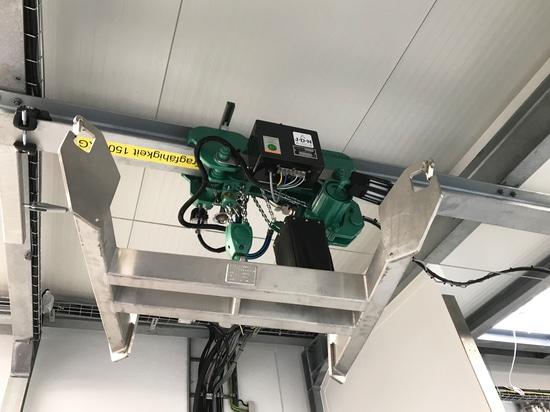 A J D Neuhaus hoist in low headroom trolley shown with radio remote control.