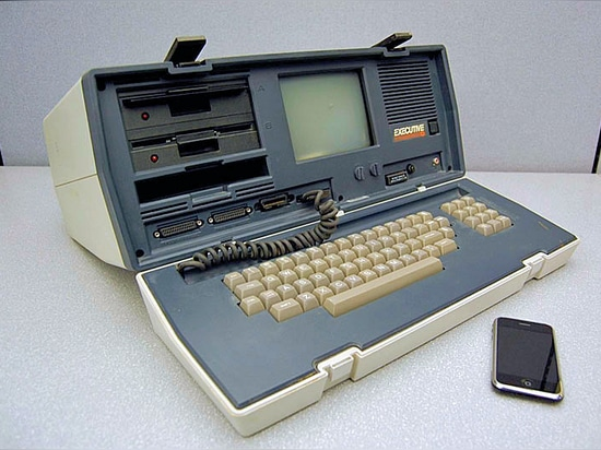 Fig. 1: the Osbourne Executive office computer produced in the early 1980s next to an Apple® iPhone® device. The phone has around 500 times the computing capability of the old computer, and its mem...