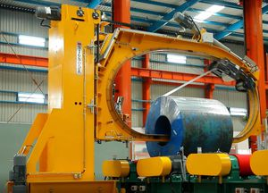 rotary ring wrapping machine / automatic / coil / with conveyor