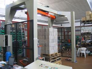 rotary arm stretch wrapping machine