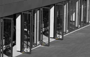 folding doors / steel / industrial / exterior