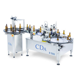 automatic labeler / for self-adhesive labels / for bottles / side