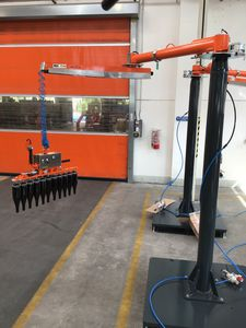 pneumatic manipulator arm / with gripping tool / with suction cup / for lifting