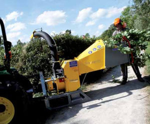 tractor-mounted wood chipper