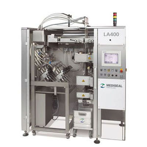 vertical bagging machine / for the pharmaceutical industry / for liquids / PLC-controlled