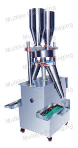 powder filling machine / for granulates / sachet / semi-automatic