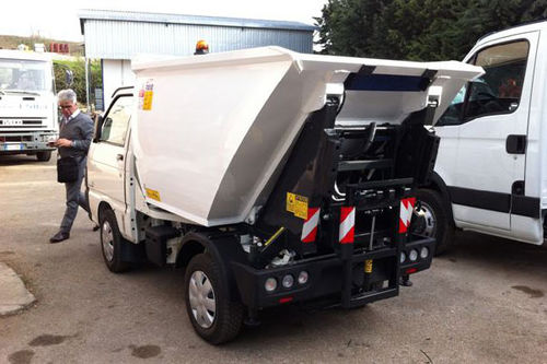top-loader waste collection vehicle
