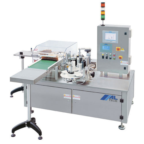 automatic labelling machine / for the pharmaceutical industry