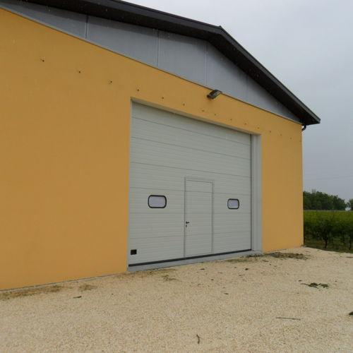 sectional door / metal / exterior / hangar
