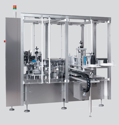 semi-automatic labelling machine / for self-adhesive labels / high-speed / rotary