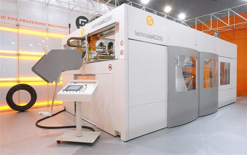automatic coiler / for tubes / for extrusion lines