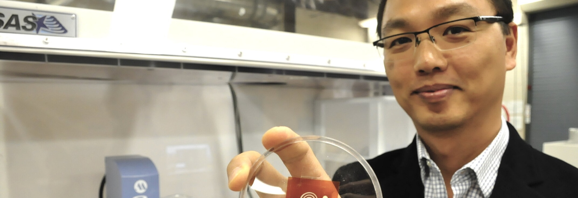 1. Simon Fraser University Mechatronic Systems Engineering professor Woo Soo Kim holds one of the sensors developed by the multi-institute team (Source: Simon Fraser University)
