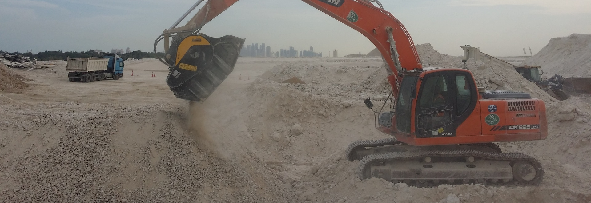 MB Crusher Bucket BF 90.3 at work on Al Khor Expressway to save time and costs.