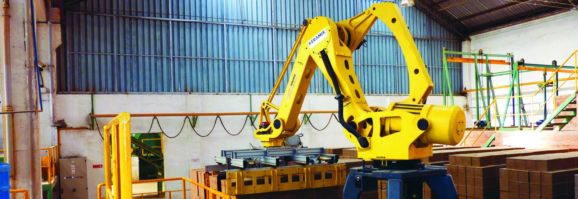 ROBOTIC PALLETIZER & STRETCH WRAPPING LINE IN GLASS WOOL INDUSTRY
