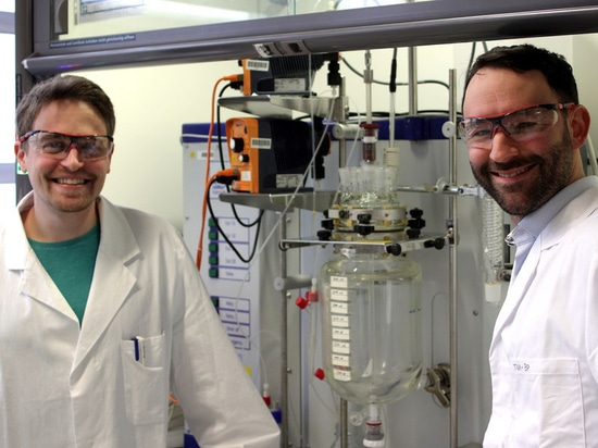 Paul Stockmann and Dr. Van Opdenbosch with the reactor in which the polymerizable monomer was produced from the natural product 3-carene.