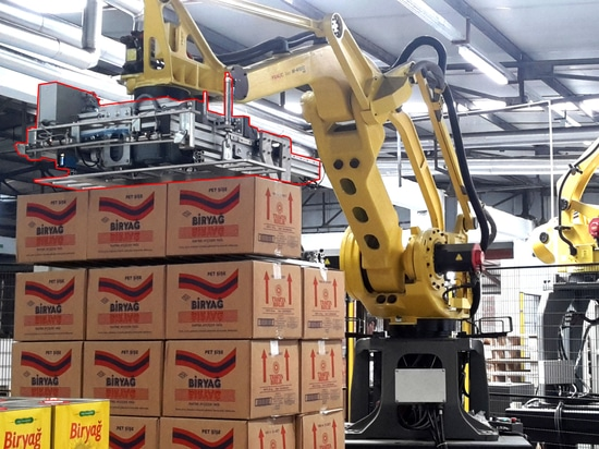 ROBOTIC TINPLATE / PARCEL STACKING AND STRETCH WINDING LINE